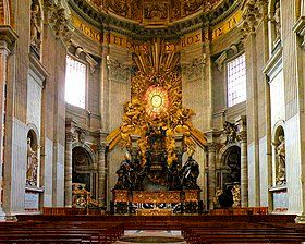 Pews before the ornate, gold-leafed throne of St. Peter