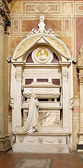 highly ornate white marble funerary monument