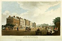 A picture of Piccadilly in 1810 showing houses, coaches with horses and pedestrians