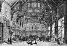 19th-century stage set showing a grand English Tudor interior