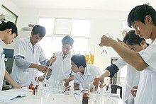 Vietnamese science students working on an experiment in their university lab.