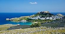 General view of the village of Lindos, with the acropolis and the beaches, island of Rhodes, Greece.