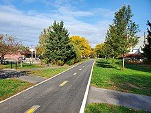 Two paved bike lanes extend into the distance