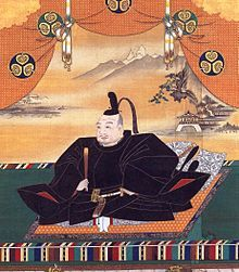 Painting of a mediaeval Asian man seated and dressed in splendour