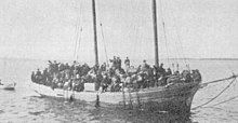 sailing ship filled with refugees