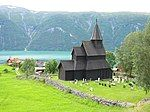 Urnes Church, a wooden building with a cemetery in front.