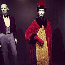 Shot of a FIDM Museum costume exhibit, highlighted by Gustave's signature uniform and Madame D's ornate coat-and-gown ensemble