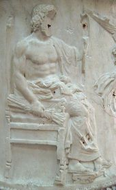 Bas-relief of Jupiter, nude from the waist up and seated on a throne