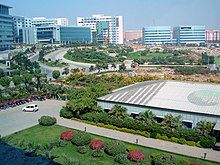 City panorama showing gardens, clean roads and modern office buildings
