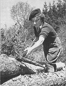 A black-and-white photograph of a uniformed woman at work