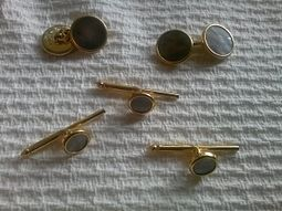 Gold and cuff links and shirt studs