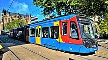 A Sheffield Supertram in current blue, orange and red Stagecoach livery.