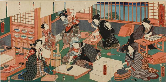 A colour print of a group of well-dressed Japanese women making prints