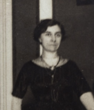 A black and white, informal photograph of a woman