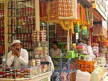 four men in a traditional bridalwear shops in the market