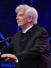 elderly man with full head of white hair in formal attire