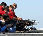 US Navy 081012-N-9610C-053 Sailors fire M16A3 rifles during small-arms qualifications aboard the Nimitz-class aircraft carrier USS John C. Stennis (CVN 74).jpg
