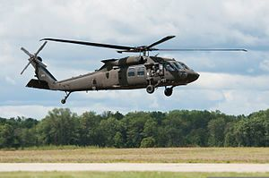 A U.S. Army UH-60M Black Hawk helicopter assigned to the 3rd Battalion, 238th Aviation Regiment prepares to land at Grayling Airfield in Grayling, Mich., Aug. 3, 2013, during Northern Strike 130803-Z-GS745-033.jpg