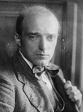 head and shoulders image of a bald, clean-shaven man of middle age