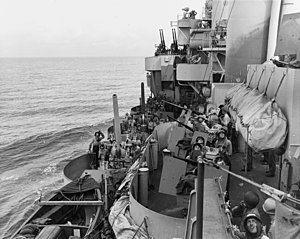 Gun crews aboard USS Phoenix (CL-46) during the Mindoro invasion, 18 December 1944 (80-G-47471).jpg