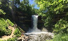 Minnehaha Falls surrounded by green summer foliage