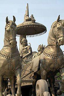 Photograph of a bronze chariot. The discourse of Krishna and Arjuna in Kurukshetra is the Bhagavad Gita.