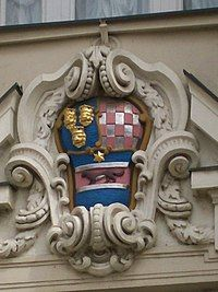 Shield with colored painting on stone building