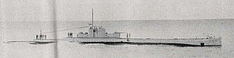 a black and white photograph of a submarine underway on the surface