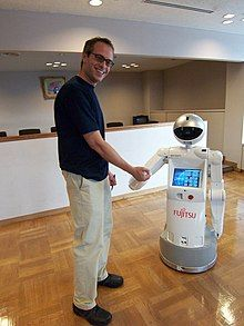 A man is shaking hands with a bot