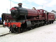 """The red locomotive train used as the """"Hogwarts Express"""" in the film series. In the front it has the numbers """"5912"""" inscripted on it"""