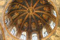 Dome of the Parecclesion interior at Chora Church showing ribs, frescos, and a drum with windows
