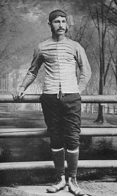 Walter Camp standing by the railing on a bridge