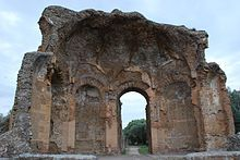 Half-missing building at Hadrian's Villa showing domed interior composed of orange peal-like sections rising from arched niches and door
