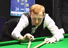 Anthony McGill playing a shot