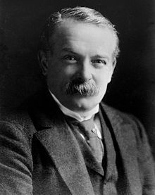 Head and shoulders of a middle-aged gentleman with a bushy moustache