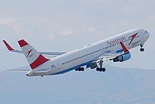 Rear quarter view of an Austrian Airlines 767, with red winglets