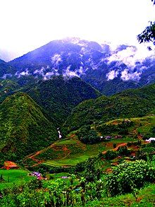 Photograph of the Sa Pa mountain hills with agricultural activity shiwn in the foreground