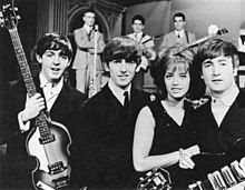 Paul McCartney, George Harrison, Swedish pop singer Lill-Babs and John Lennon on the set of the Swedish television show Drop-In in 1963