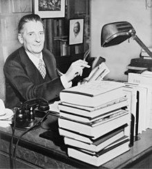 Photographic of Maxwell Perkins sitting at a desk