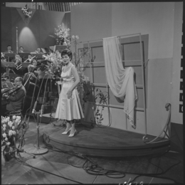 Photo of Lys Assia, the first winner of the Eurovision Song Contest, performing at the third contest in 1958.