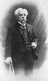 portrait of middle-aged man with white hair and moustache