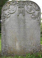 Colour photograph of a sandstone headstone