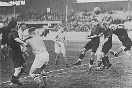 Aerial play with two Belgian players and the Luxembourg keeper trying to touch the ball