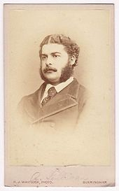 Head and shoulders of Sullivan as a young man, wearing a moustache, long sideburns and a serious expression