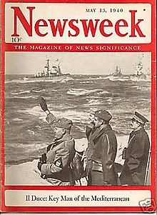 """Cover of Newsweek magazine, 13 May 1940, showing Mussolini saluting navy revue from shore, with headline """"Il Duce: key man of the Mediterranean""""."""