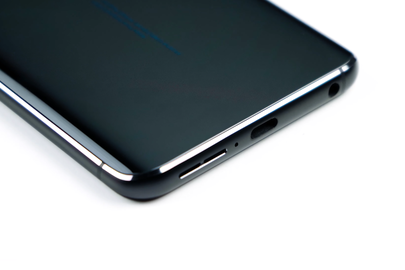 A speaker outlet, USB-C port, and headphone jack on the bottom edge of the phone