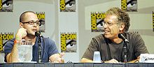 Damon Lindelof and Carlton Cuse sitting, speaking into microphones.