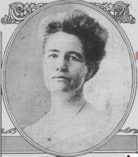A black and white head-shot photograph of a woman