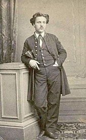 young man in 19th-century college uniform
