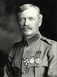 Burnham portrait photograph taken in 1901. He is dressed in his British Army uniform, with major insignia, Distinguished Service Order Cross, British South Africa Medal, and Queens South Africa Medal.